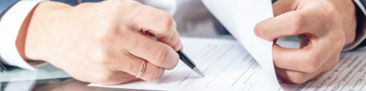 businessman-sitting-table-signing-documents-office-close-up_97716-105